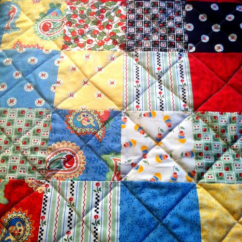Cherry charm square quilt