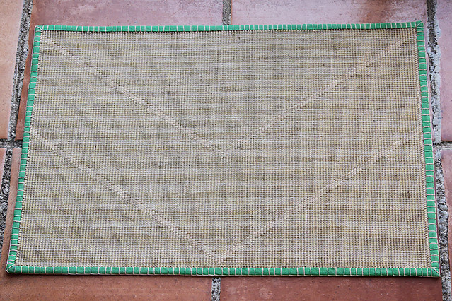 Doormat repair complete - wire holds down the corners and binding add colour