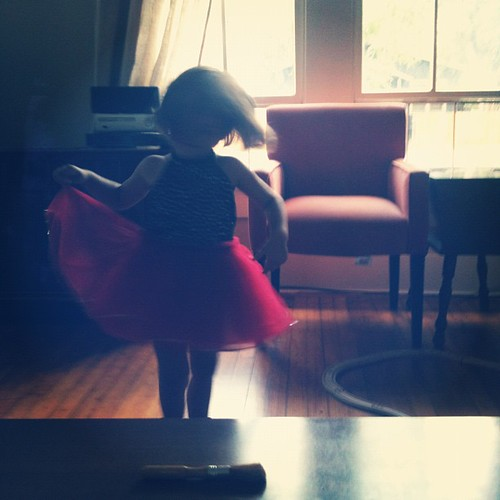 Dressed as a ladybug, twirling to the Amelie soundtrack.
