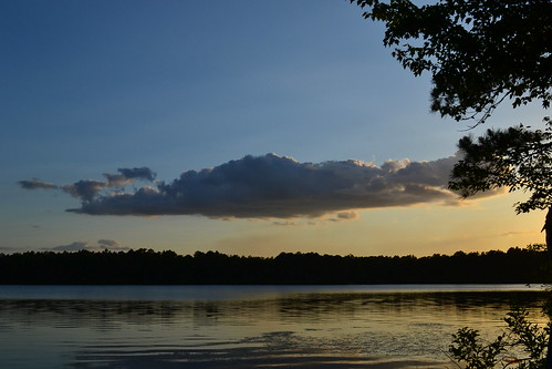 sunset lake silhouette clouds