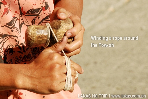 The traditional Ifugao Trumpo, Fow-oh, being winded with a rope