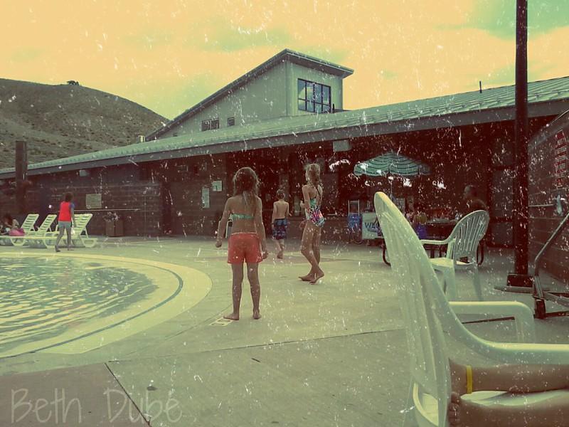 Emma playing catch at pool wm