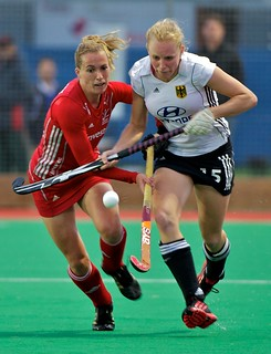 Great Britain's Laura Bartlett and Germany's Hannah Kruger go shoulder to shoulder for the ball
