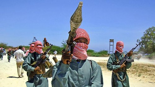 Al-Shabaab fighters conducting military drills outside the Somalian capital of Mogadishu. The US is behind an international attempt to crush the resistance movement. by Pan-African News Wire File Photos