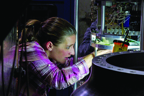 A worker checks a laser diagnostic used on the Barolo subcritical experiment.