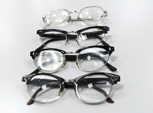 Evidence of life: 1950's eye glasses, 4 pair, thick lens, donations, Lenscrafters, Northgate, Seattle, Washington, USA