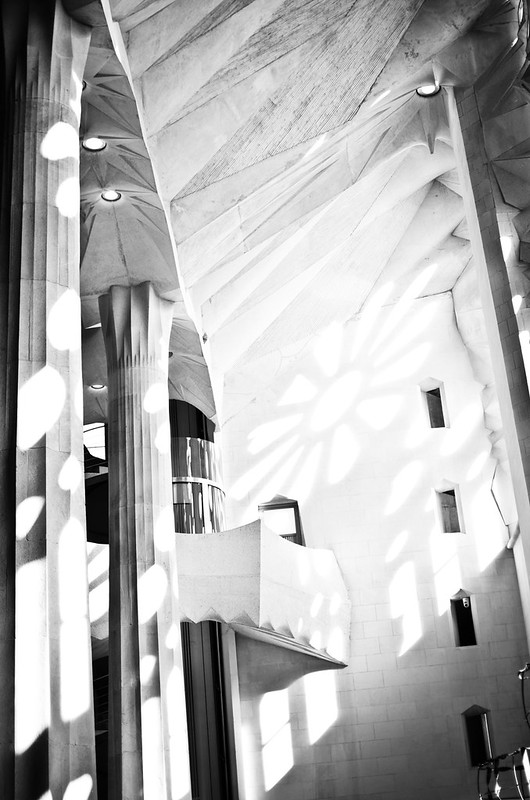 Huge windows cast beautiful light and shadows in Gaudi's still unfinished masterpiece, La Sagrada Familia.