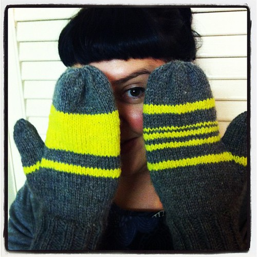 My fluorescent yellow & grey mittens are done! #knitgeek