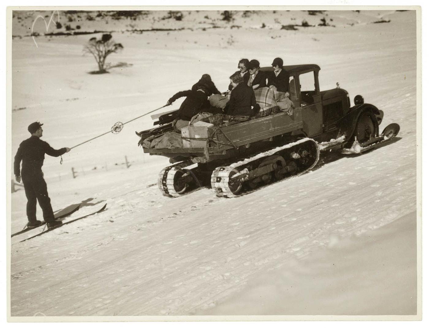 Truck with caterpillar tread pulls skier through the snow, Kosciusko, 193- / photographer Sam Hood