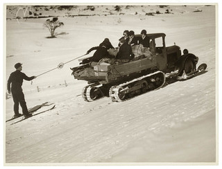 Truck with caterpillar tread pulls skier through the snow, Kosciusko, 193- / photographer Sam Hood