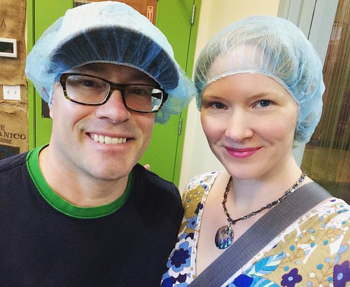 A couple of dorks touring a chocolate factory for funsies.