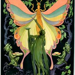 Mon, 2018-05-21 15:53 - 'Putnam Fadeless Dyes-Tints.'  A late 1920s paper advertising fan with a wooden handle. The elaborate Art Nouveau design of the fan features a green nymph in flowing robes who's using Putnam Fadeless Dyes and Tints to paint colors onto the wings of a quizzical-looking butterfly. Two other leafy green creatures kneel on either side as they hold bowls of Putnam products. Purple gnarly tree trunks and branches along with green leaves frame the fantastical scene.  See also the advertising copy on the back of the fan.