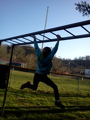 Bre monkey bars at the park
