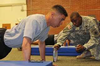 JOINT BASE LEWIS-McCHORD, Wash. -   Spc. Andrew Lester (left), healthcare specialist with the 62nd Medical Brigade, does pushups as part of the Army physical fitness test, during the I Corps Soldier of the Year Competition on Joint Base Lewis-McChord, Jun