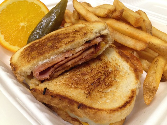 Grilled ham and cheese sandwich and fries