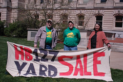 KFTC members at the state capital for last year's HB 127 Yard Sale, promoting our work on tax reform