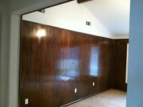 Before, living room with paneling