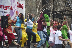 Volunteers dance with NYC Bhangra