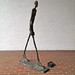 Small photo of Walking Man by Alberto Giacometti