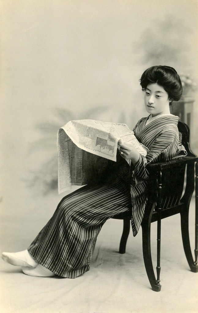 Geiko Tomigiku reading a Newspaper 1921