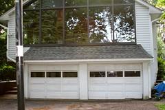 backyard, outdoor structure, building, garage door, garage, property, cottage, siding, real estate, home,