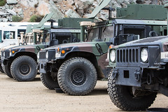 off road racing(0.0), armored car(1.0), army(1.0), automobile(1.0), military vehicle(1.0), sport utility vehicle(1.0), vehicle(1.0), off-roading(1.0), humvee(1.0), jeep(1.0), off-road vehicle(1.0), bumper(1.0), military(1.0),