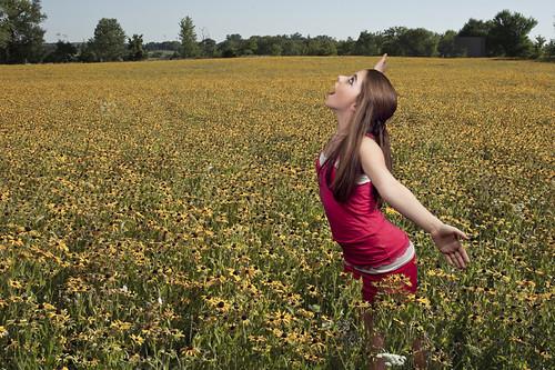 In a field of flowers by The Shutterbug Eye™