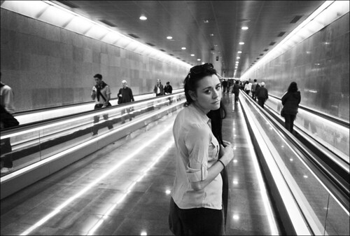 girl in long tunnel with nice lights