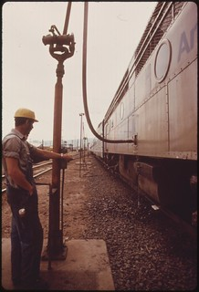 Expo '74 passenger train is serviced at the Wenatchee Washington, train station during a 10 minute stop enroute from Spokane to Seattle, June 1974