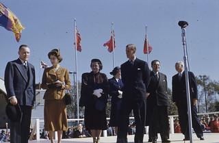 Princess Elizabeth and Prince Philip standing on stage with three men and two women / La princesse Élisabeth debout sur une estrade avec prince Philip, trois hommes et deux femmes