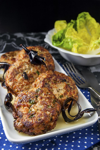 Salmon-Eggplant cakes served with a cardamom-butter court-bouillon sauce