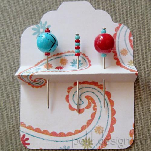 Aqua & red pins