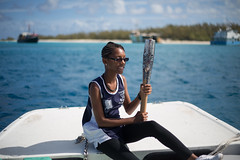 The Queen's Baton carried by D'Janelle Tennant, in Grand Turk Island, Turks and Caicos Islands, Thursday 17 April 2014. Turks and Caicos Islands is nation 56 of 70 nations and territories the Queen's Baton will visit....
