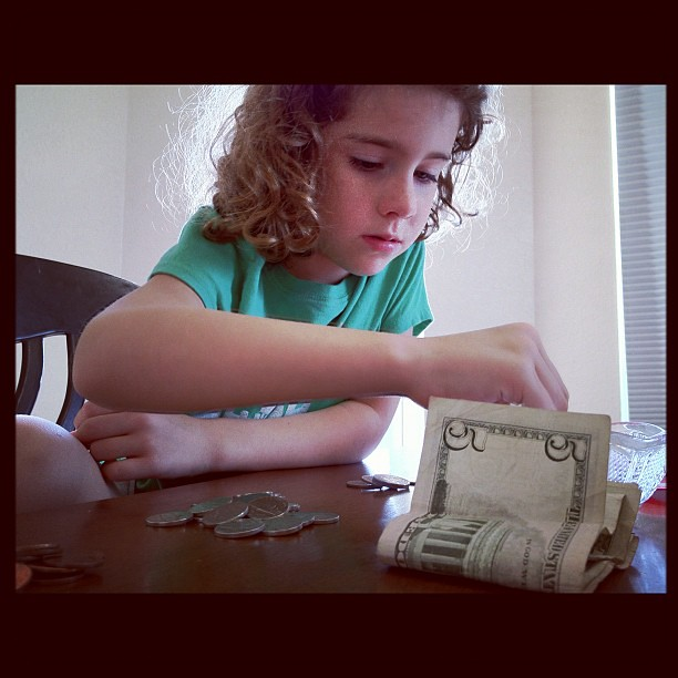 Counting her Easter, tooth fairy, and allowance money in hopes of having enough to buy a dress for her new doll...