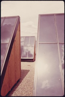 Flat plate solar heating collectors built by the Solaron Corporation and installed on the roof of the Gump Glass Company..., 05/1975.