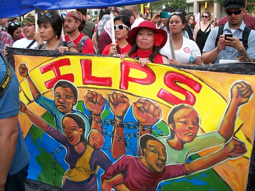 Banner of the International League of People's Struggle (ILPS) in the anti-NATO march held in Chicago on May 20, 2012. Thousands defied state repression to express their opposition to war, racism and military occupation. (Photo: Abayomi Azikiwe) by Pan-African News Wire File Photos