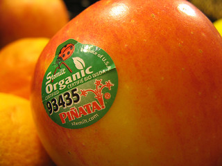 a photo of a red apple with an organic sticker on it