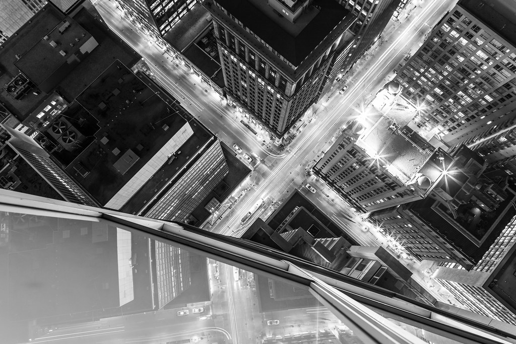 looking down at a toronto intersection rooftopping in black and white