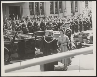 The Lord Mayor of Hobart, Sir Richard Harris, receives the Queen after she leaves her car in front of Hobart Town Hall, Tasmania, 1954.