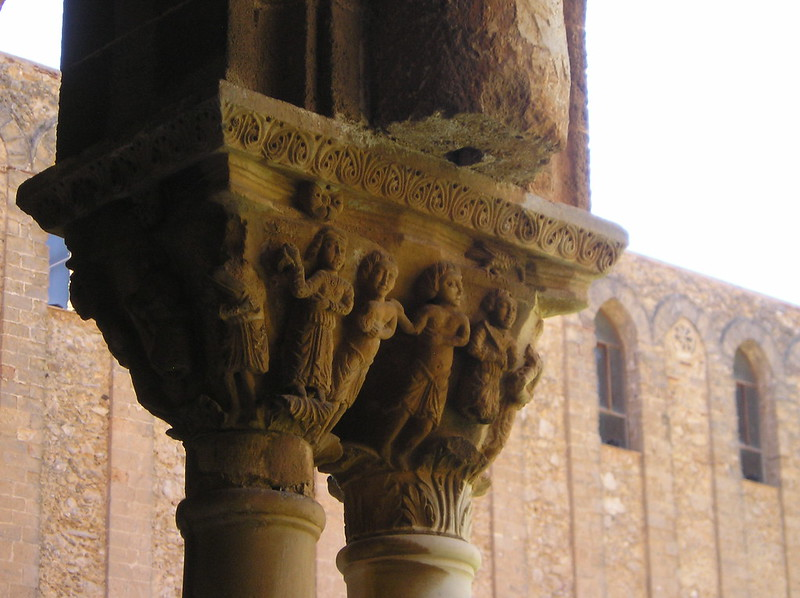 Infantry with round ended sword carved column capitals in
