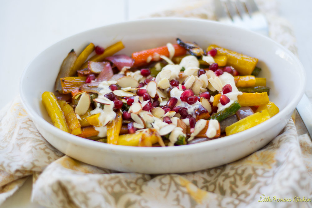 Colorful vegetables are tossed with tangy pomegranate molasses and honey before being roasted and caramelized. Then finished with a good drizzle of creamy tahini sauce ,pomegranate seeds and almonds. #pomegranatemolasses