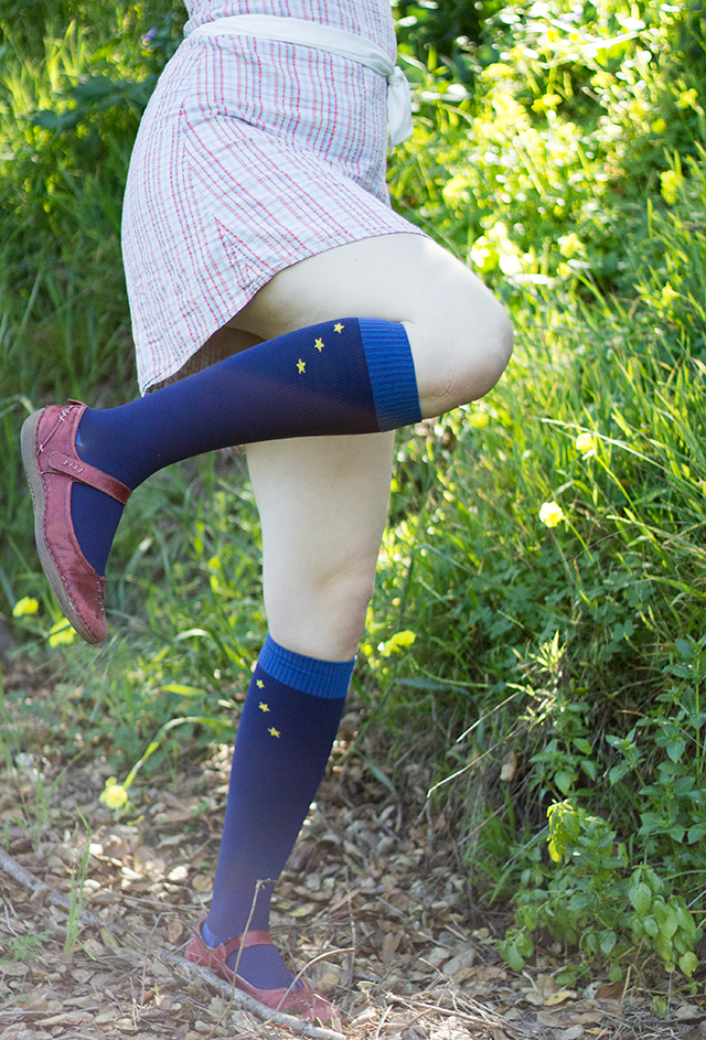 pastel plaid mini dress, navy blue knee socks with yellow stars, brick red Mary Janes