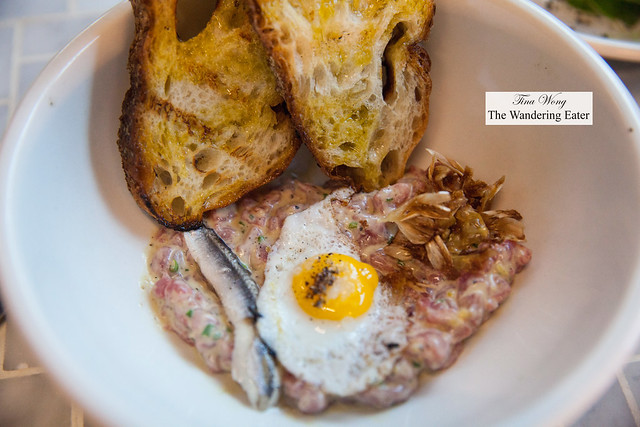 Steak tartare, artichoke leaves, worcestershire, bocquerone, quail egg