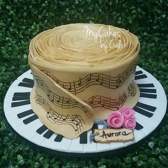 A scroll music sheet inspired cake by MyCakes by Cielo