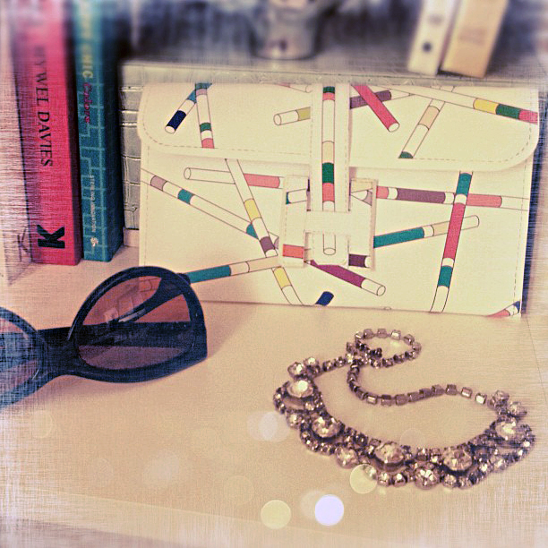 hermes clutch - rhinestone necklace - sunglasses