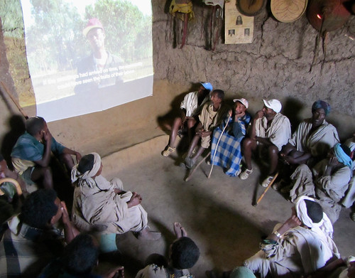 Community members watch the films and comment