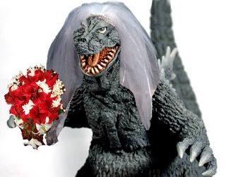 A Godzilla statue wearing a bridal veil