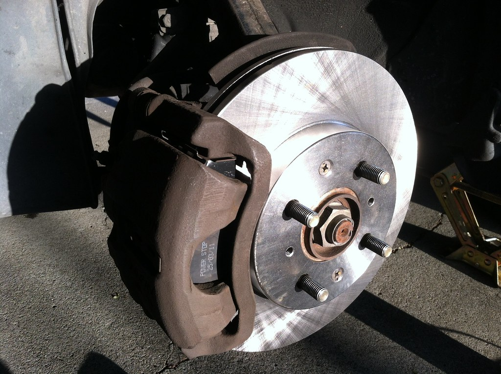 Brake's making a grinding noise, new pads and rotors
