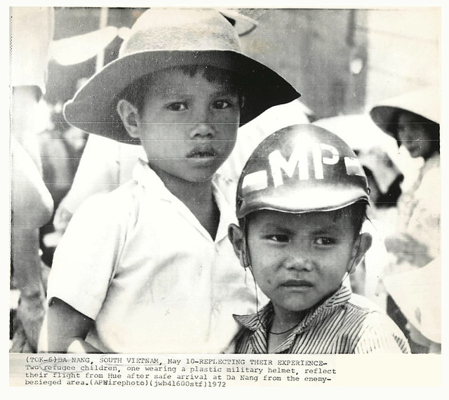 1972 Vietnamese Refugee Boy From Hue Wearing Toy MP Helmet - Press Photo