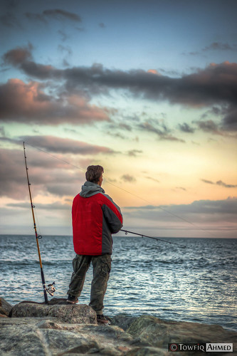 ocean camera sunset portrait sky cloud fish newyork slr nature clouds canon landscape outdoors photography rebel fisherman rocks flickr outdoor candid pole rod casual dslr digitalslr skyclouds angler rebelxs 1000d towfiqahmed